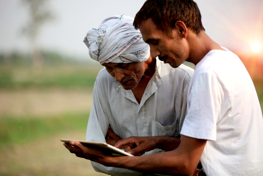 Agronomist consulting with farmer outdoor in the field